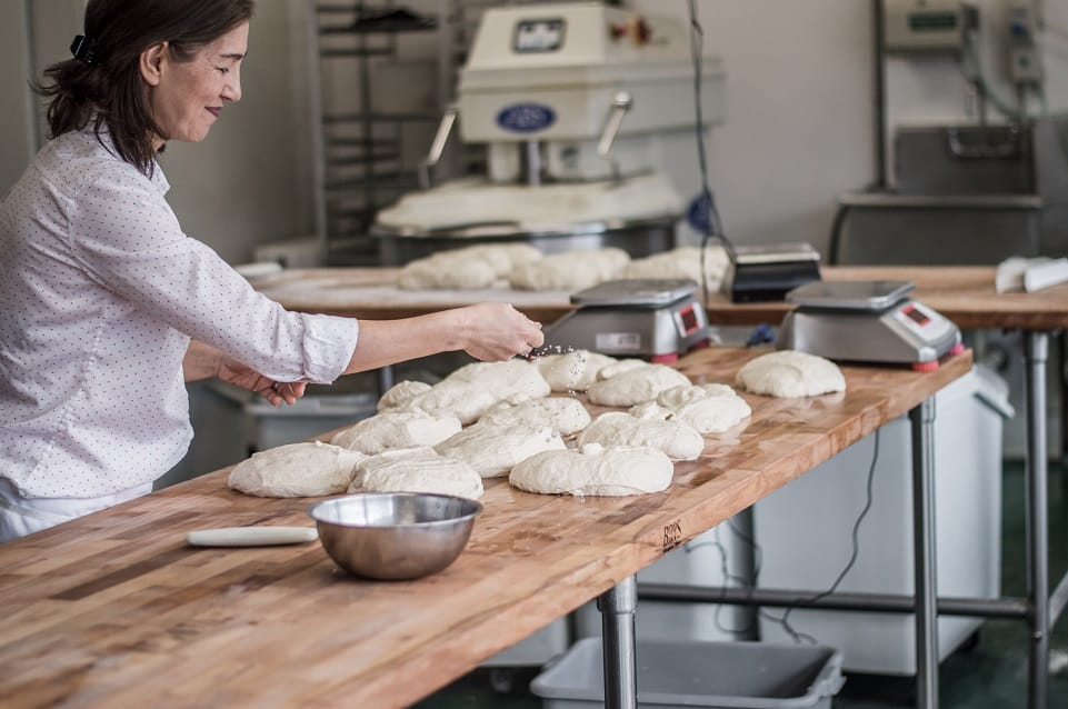 A woman preparing dough for baking